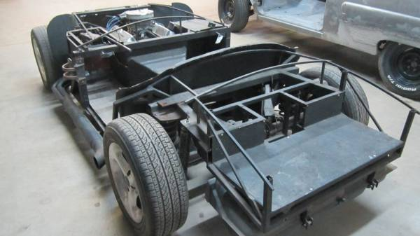 Chassis and components on arrival at the shop.